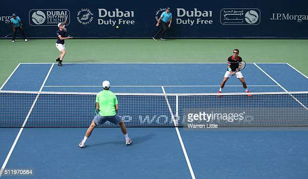 Jamie Murray of Great Britain and Tommy Robredo of Spain in action against Henri Kontinen of Finland and John Peers of Australia in the Men's Doubles...