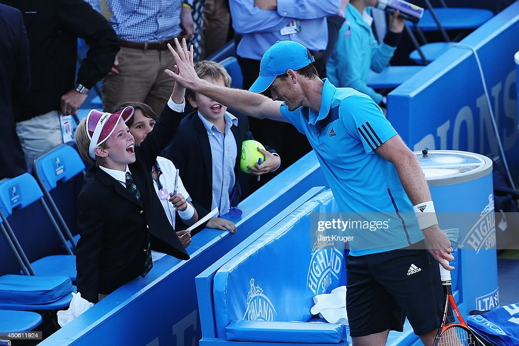 Jamie Murray of Great Britain celebrates with youngsters in the crowd after he and John Peers of Australia defeat Julien Benneteau of France and Edouard Roger-Vasselin of France during their Men's Doubles semi-final match on day six of the Aegon Championships at Queens Club on June 14, 2014 in London, England.