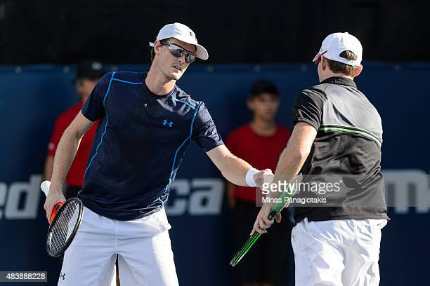 Jamie Murray of Great Britain encourages teammate John Peers of Australia during their doubles match against Leander Paes of India and Andy Murray of...