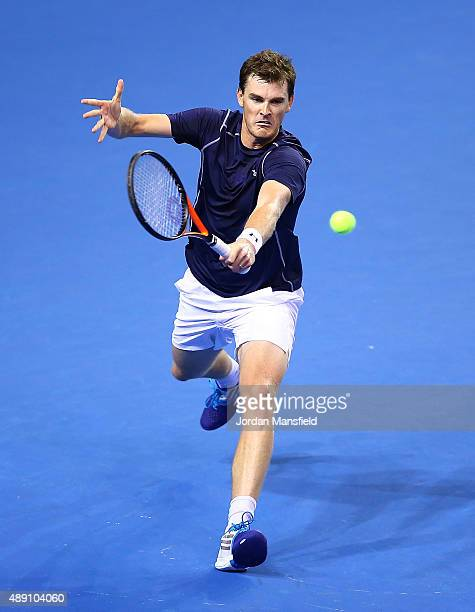Jamie Murray of Great Britain hits a return during Day Two of the Davis Cup Semi Final match between Great Britain and Australia at Emirates Arena on...