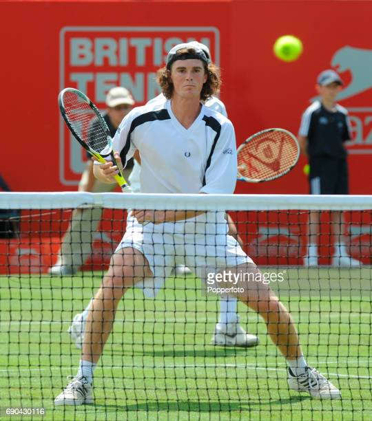 Jamie Murray of Great Britain in action during the mens doubles match with partner Jeff Coetzee of South Africa against Eric Butorac and Bobby...