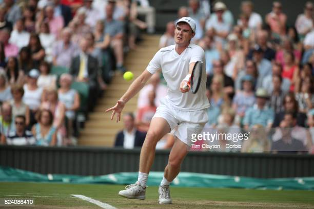 Jamie Murray of Great Britain in action with Martina Hingis of Switzerland during the Mixed Doubles Final on Center Court during the Wimbledon Lawn...