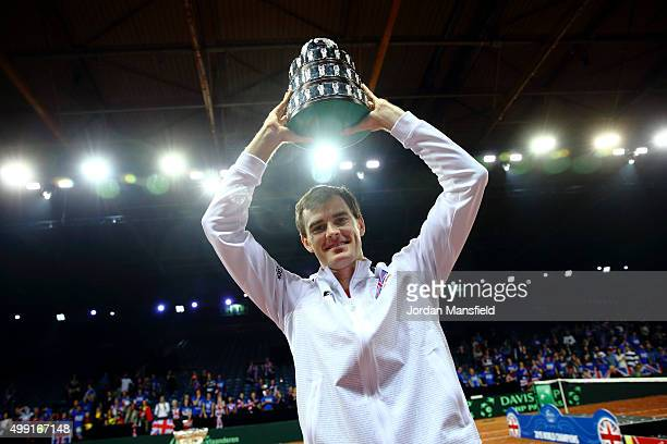 Jamie Murray of Great Britain lifts his trophy following their victory during day three of the Davis Cup Final match between Belgium and Great...