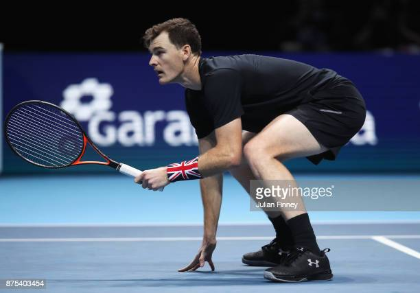Jamie Murray of Great Britain looks on partnering Bruno Soares of Brazil in the Doubles match against Lukasz Kubot of Poland and Marcelo Melo of...