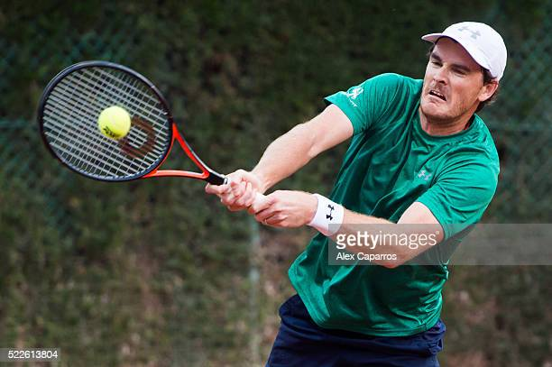 Jamie Murray of Great Britain plays a backhand during his match with Bruno Soares of Brazil against Henri Kontinen of Finland and John Peers of...
