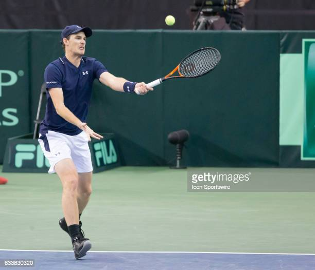 Jamie Murray of Great Britain returns a serve against Vasek Pospisil and Daniel Nestor of Canada in men's doubles play on February 04 during the...