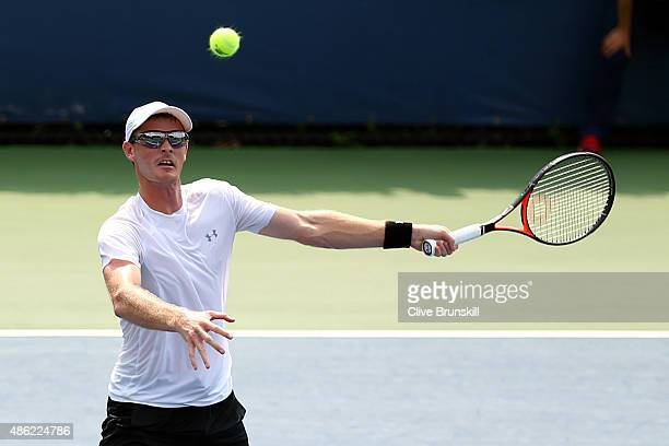 Jamie Murray of Great Britain returns a shot to Bjorn Fratangelo and Dennis Novikov of the USA during their Men's Doubles First Round Match on Day...