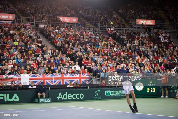 Jamie Murray of Great Britain serves against Vasek Pospisil and Daniel Nestor of Canada in men's doubles play on February 04 during the Davis Cup...