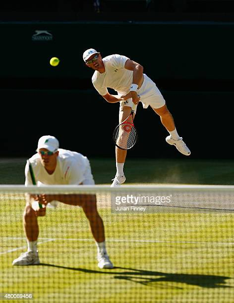 Jamie Murray of Great Britain serves playing with partner John Peers of Australia in the Gentlemens Doubles Semi Final match against Jonathan Erlich...
