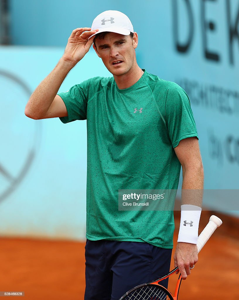 <a gi-track='captionPersonalityLinkClicked' href=/galleries/search?phrase=Jamie+Murray+-+Tennis+Player&family=editorial&specificpeople=4393751 ng-click='$event.stopPropagation()'>Jamie Murray</a> of Great Britain shows his dejection against Henri Kontinen of Finland and John Peers of Australia in their doubles match during day six of the Mutua Madrid Open tennis tournament at the Caja Magica on May 05, 2016 in Madrid,Spain