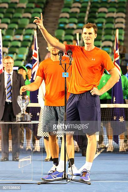Jamie Murray of Great Britain speaks during the presentation of the winners trophy after his Men's Doubles Final match with Bruno Soares of Brazil...