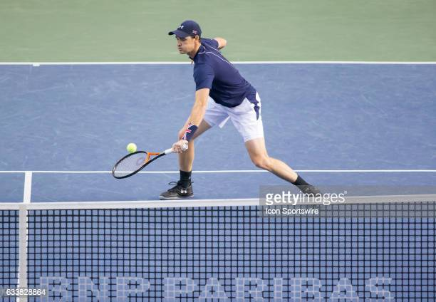 Jamie Murray of Great Britain volleys the ball back against Vasek Pospisil and Daniel Nestor of Canada in men's doubles play on February 04 2017...