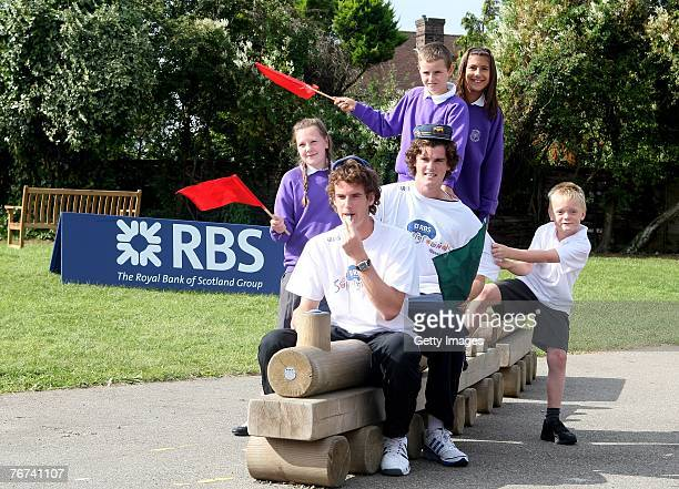 Jamie Murray sits behind his brother Britains no 1 tennis player and Ambassador Andy Murray with Pupils from Dorchester Primary School during the RBS...