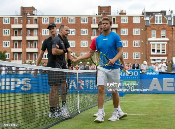 Jamie Murray with partner Bruno Soares after their victory over Ryan Harrison and Michael Venus in the Men's Doubles Quarter Finals Match during Day...