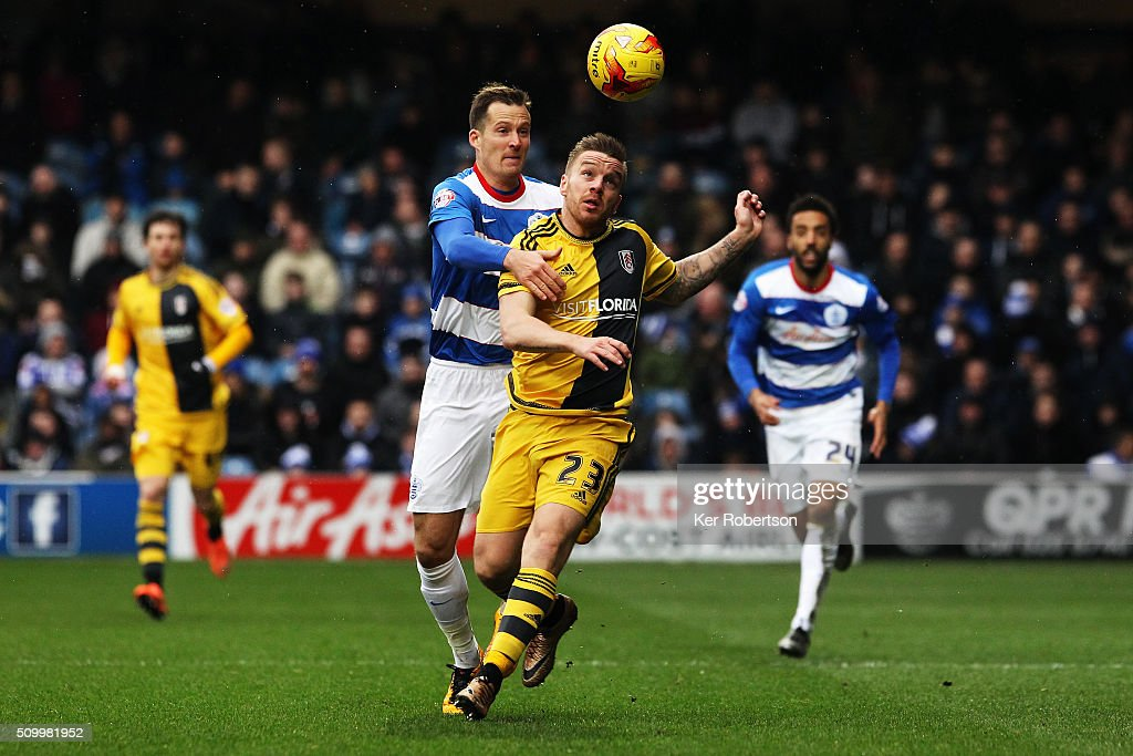 Jamie O'Hara (R) of Fulham holds off Daniel Tozser (L) of Queens Park Rangers during the Sky Bet Championship match between Queens Park Rangers and Fulham at Loftus Road on February 13, 2016 in London, United Kingdom.