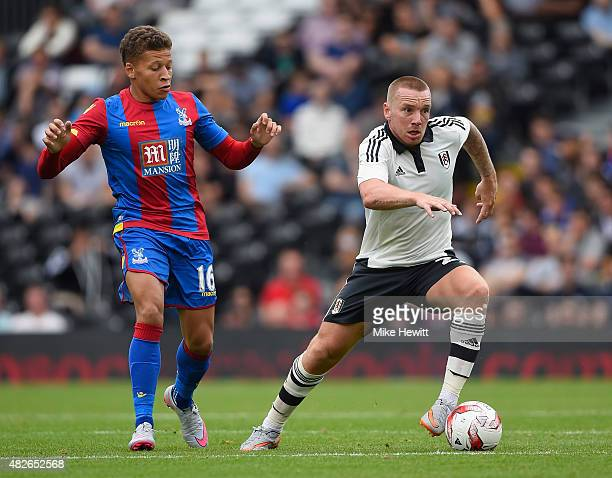 Jamie O'Hara of Fulham is challenged by Dwight Gayle of Crystal Palace during a Pre Season Friendly between Fulham and Crystal Palace at Craven...