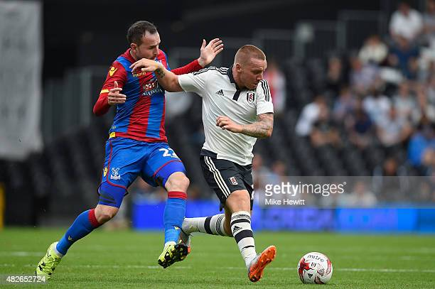 Jamie O'Hara of Fulham is challenged by Jordon Mutch of Crystal Palace during a Pre Season Friendly between Fulham and Crystal Palace at Craven...