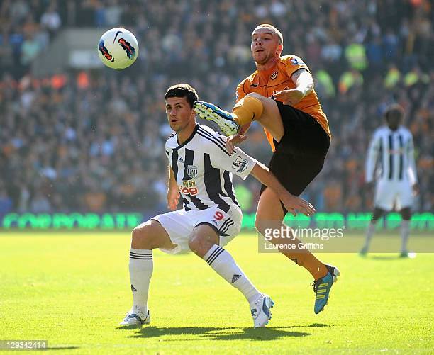 Jamie O'Hara of Wolverhampton Wanderers battles with Shane Long of West Bromwich Albion during the Barclays Premier League match between West...