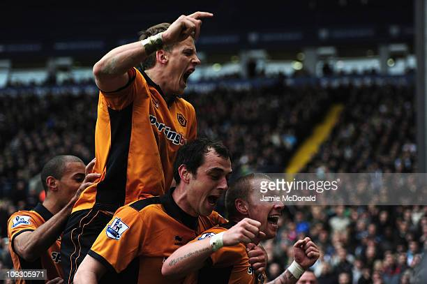 Jamie O'Hara of Wolverhampton Wanderers celebrates his goal with team mates during the Barclays Premier League match between West Bromwich Albion and...