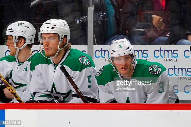 Jamie Oleksiak and John Klingberg of the Dallas Stars look on against the New Jersey Devils on March 26 2017 at Prudential Center in Newark New...