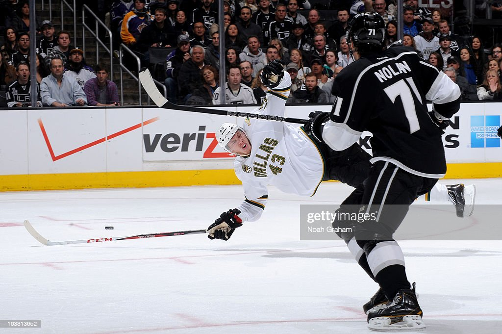 Jamie Oleksiak #43 of the Dallas Stars flies through the air against the Los Angeles Kings at Staples Center on March 7, 2013 in Los Angeles, California.