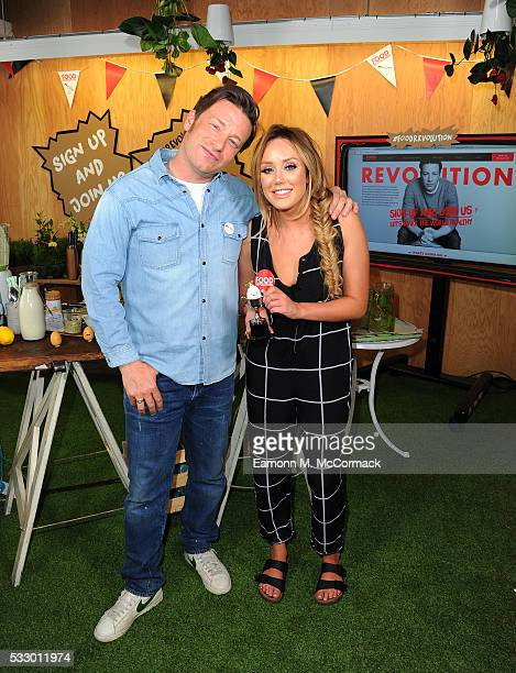 Jamie Oliver and Charlotte Crosby take part Jamie Oliver's Food Revolution Day on May 20 2016 in London United Kingdom Jamie Oliver launches a...