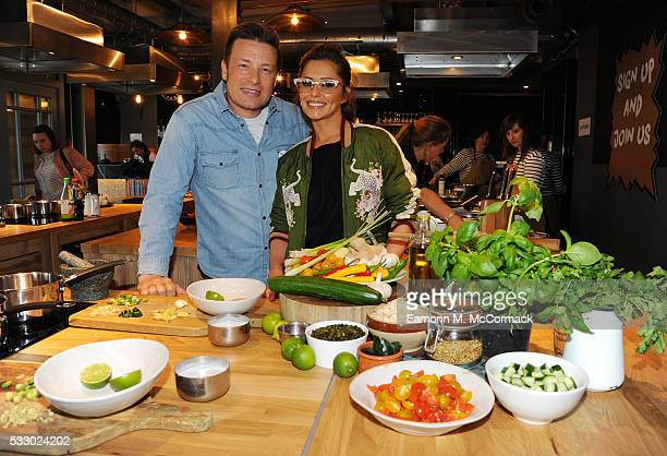 Jamie Oliver and Cheryl Cole take part in Jamie Oliver's Food Revolution Day on May 20 2016 in London United Kingdom Jamie Oliver joins Cheryl Cole...