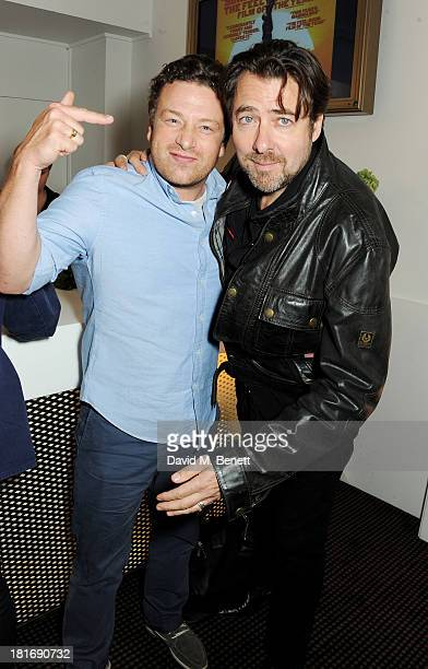 Jamie Oliver and Jonathan Ross attend a special screening of 'Sunshine On Leith' hosted by Jamie Oliver and Dexter Fletcher at BAFTA on September 23...