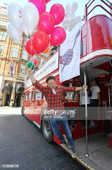 Jamie Oliver attends a photocall during activities on Food Revolution Day in Leicester Square on May 15 2015 in London England