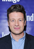 Jamie Oliver attends the Indigo and Chef Jamie Oliver celebration of the release of 'Jaime's Comfort Food' at Buca on September 30 2014 in Toronto...