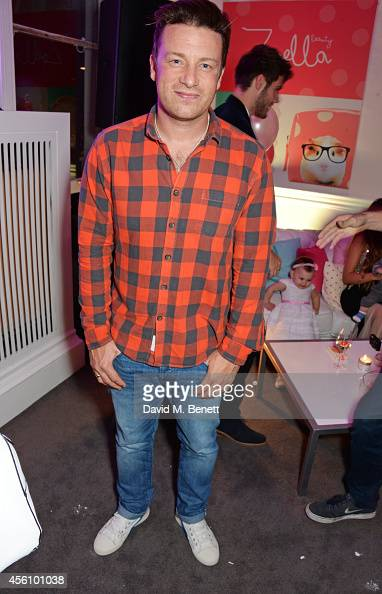 Jamie Oliver attends YouTube phenomenon Zoe Sugg's launch of her debut beauty collection at 41 Portland Place on September 25 2014 in London England