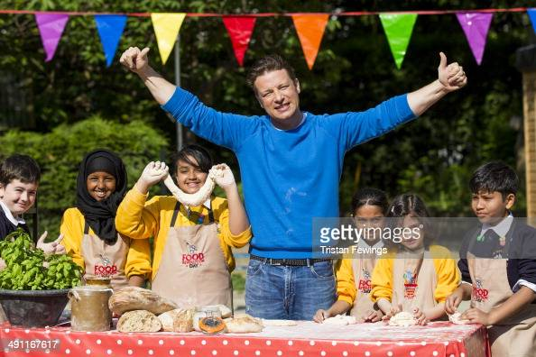 Jamie Oliver joins children from St Paul's Whitechapel CE Primary school to celebrate the third annual Food Revolution Day on May 16 2014 in London...