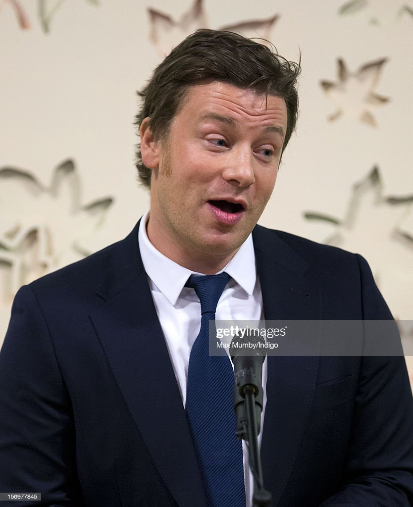 Jamie Oliver makes a speech as he, accompanied by Prince Charles, Prince of Wales, visits Carshalton Boys Sports College to see how the school has transformed its approach to healthy eating on November 26, 2012 in Carshalton, England.