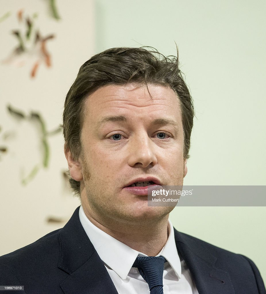 <a gi-track='captionPersonalityLinkClicked' href=/galleries/search?phrase=Jamie+Oliver&family=editorial&specificpeople=159384 ng-click='$event.stopPropagation()'>Jamie Oliver</a> makes a speech during a visit to Carshalton Boys Sports college withÊPrince Charles, Prince of Wales to see how the school has transformed its approach to healthy eating on November 26, 2012 in Carshalton, England.