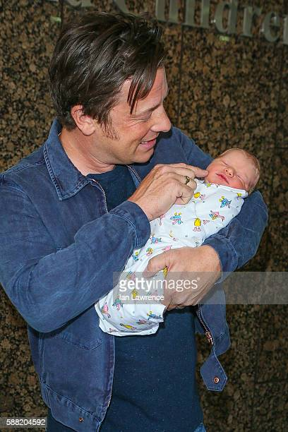 Jamie Oliver poses with his new baby at The Portland Street Hospital on August 8 2016 in London England