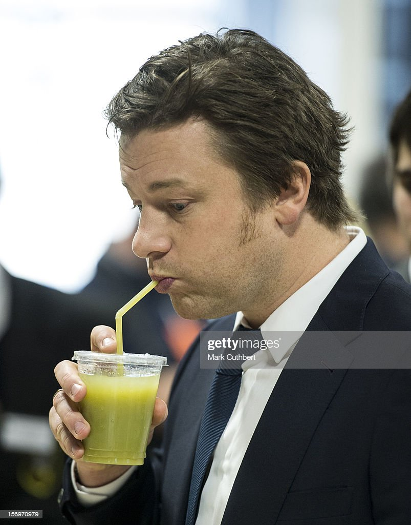<a gi-track='captionPersonalityLinkClicked' href=/galleries/search?phrase=Jamie+Oliver&family=editorial&specificpeople=159384 ng-click='$event.stopPropagation()'>Jamie Oliver</a> tries a fruit smoothie during a visit with Prince Charles, Prince of Wales to Carshalton Boys Sports college to see how the school has transformed its approach to healthy eating on November 26, 2012 in Carshalton, England.