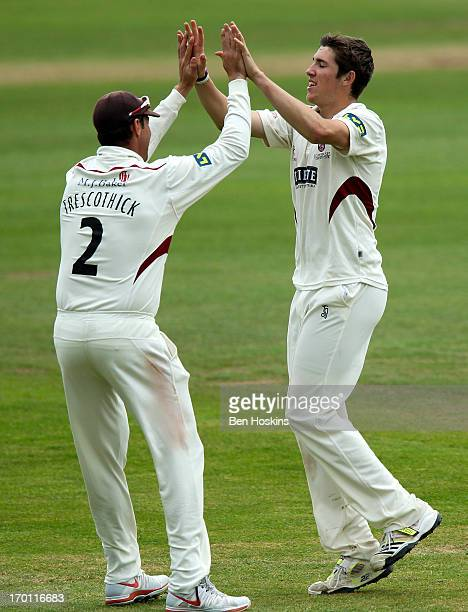 Jamie Overton of Somerset celebrates with Marcus Trescothick after taking the wicket of Keaton Jennings of Durham during the LV County Championship...