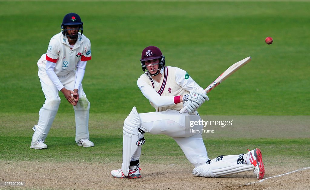 <a gi-track='captionPersonalityLinkClicked' href=/galleries/search?phrase=Jamie+Overton&family=editorial&specificpeople=7969888 ng-click='$event.stopPropagation()'>Jamie Overton</a> of Somerset hits out during Day Three of the Specsavers County Championship Division One match between Someret and Lancashire at the County Ground on May 03, 2016 in Somerset, United Kingdom.