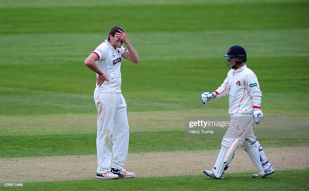 <a gi-track='captionPersonalityLinkClicked' href=/galleries/search?phrase=Jamie+Overton&family=editorial&specificpeople=7969888 ng-click='$event.stopPropagation()'>Jamie Overton</a> of Somerset(L) reacts during Day One of the Specsavers County Championship match between Somerset and Lancashire at the County Ground on May 01, 2016 in Somerset, United Kingdom.