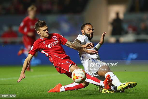 Jamie Paterson of Bristol City has a shot blocked by Kyle Bartley of Leeds United during the Sky Bet Championship match between Bristol City and...