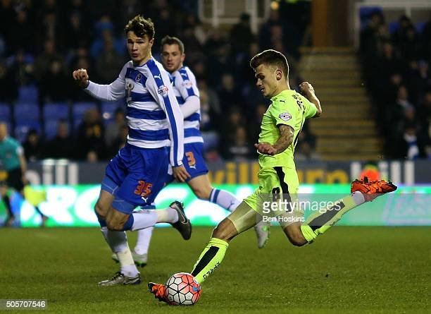 Jamie Paterson of Huddersfield scores the opening goal of the game during The Emirates FA Cup Second Round match between Reading and Huddersfield...