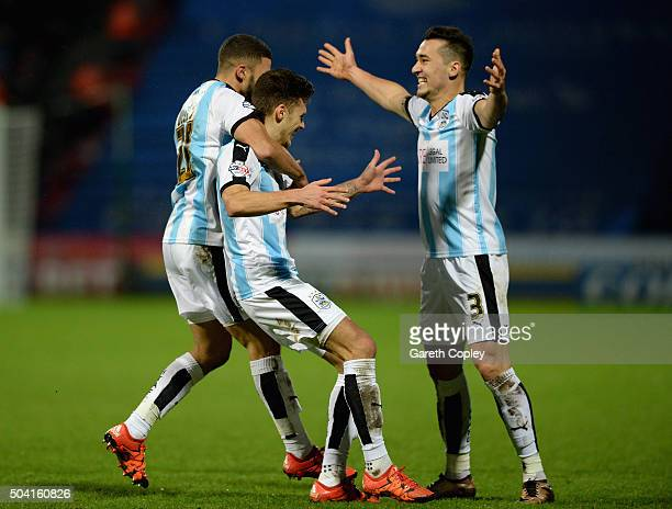 Jamie Paterson of Huddersfield Town celebrates scoring with Nahki Wells and Jason Davidson during The Emirates FA Cup Third Round between...