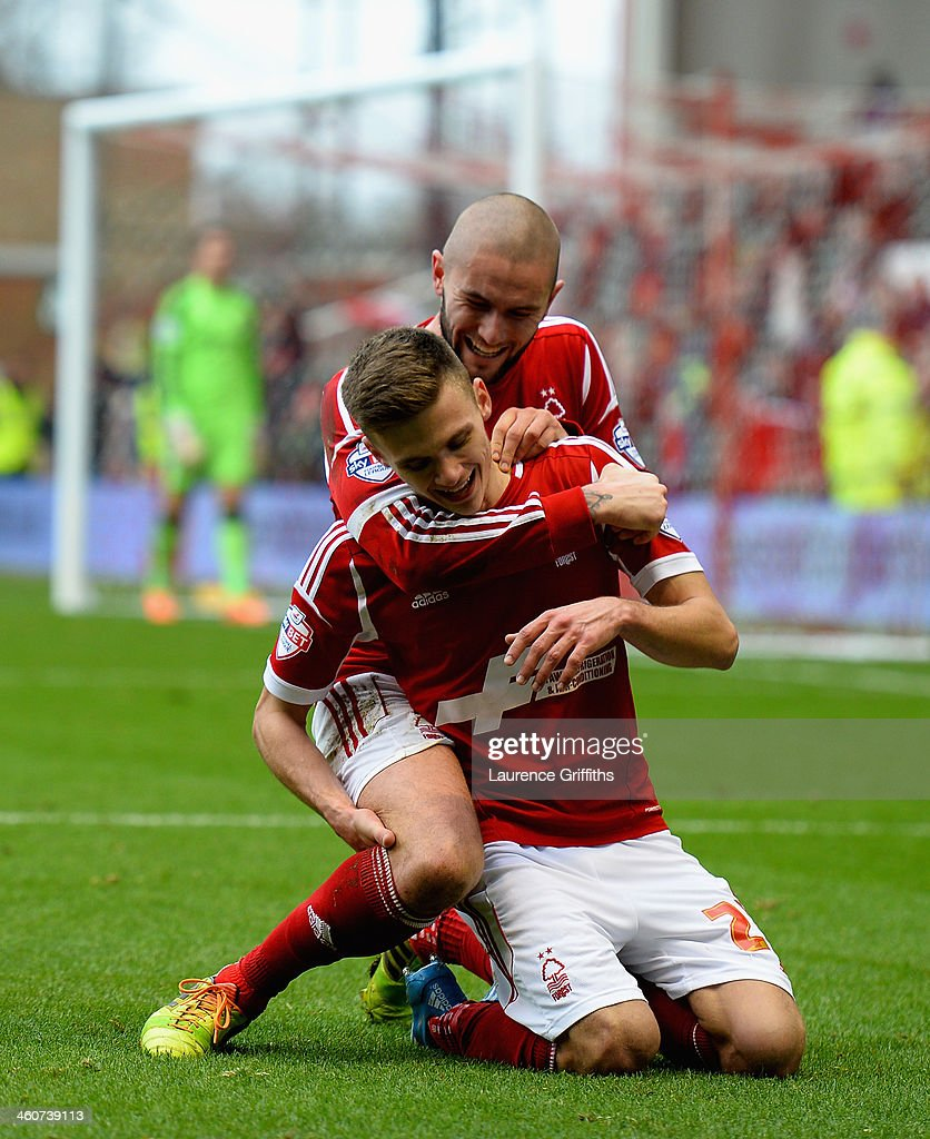 Jamie Paterson of Nottingham Forest celebrates scoring his third goal with Henri Lansbury goal during the Budweiser FA Cup Third Round match between between Nottingham Forest and West Ham United at City Ground on January 5, 2014 in Nottingham, England.