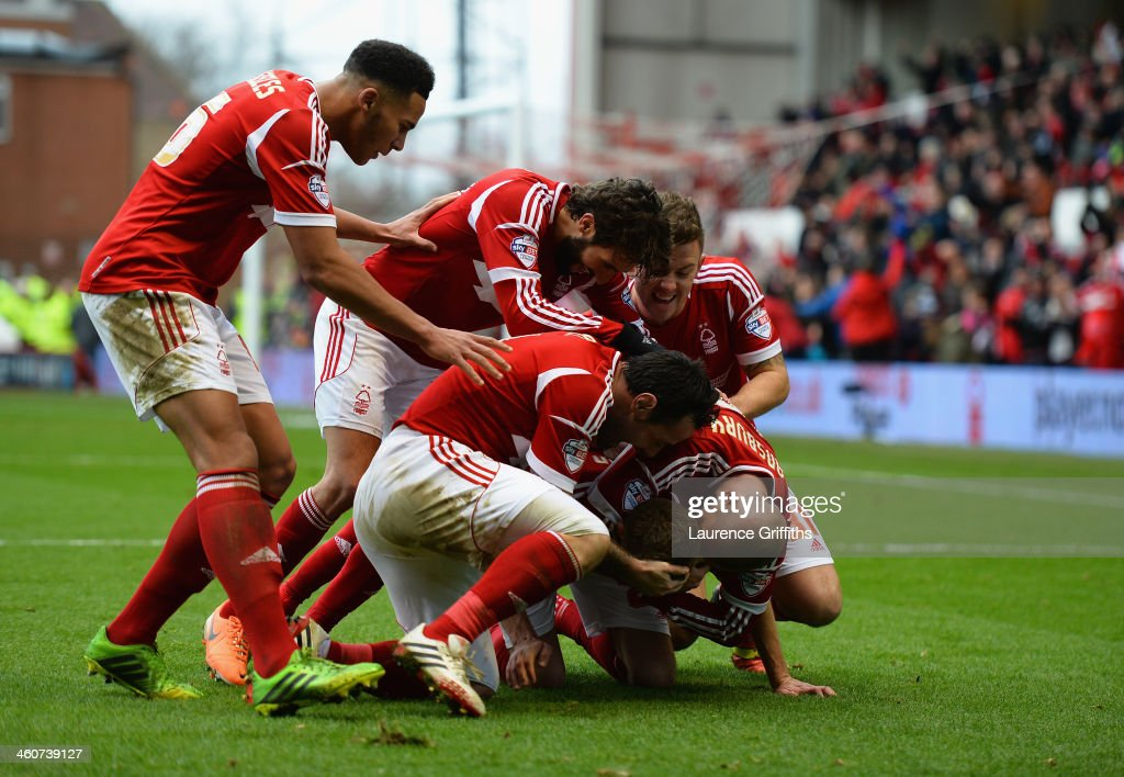 Jamie Paterson of Nottingham Forest celebrates scoring his third goal during the Budweiser FA Cup Third Round match between between Nottingham Forest and West Ham United at City Ground on January 5, 2014 in Nottingham, England.