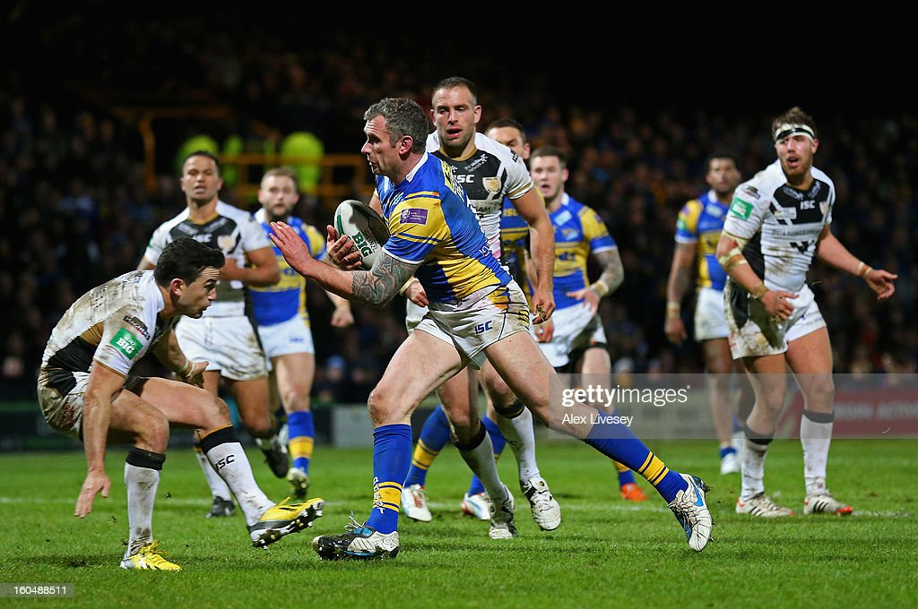 <a gi-track='captionPersonalityLinkClicked' href=/galleries/search?phrase=Jamie+Peacock&family=editorial&specificpeople=594610 ng-click='$event.stopPropagation()'>Jamie Peacock</a> of Leeds Rhinos beats Shannon McDonnell of Hull FC on his way to scoring his try during the Stobart Super League match between Leeds Rhinos and Hull FC at Headingley Carnegie Stadium on February 1, 2013 in Leeds, England.
