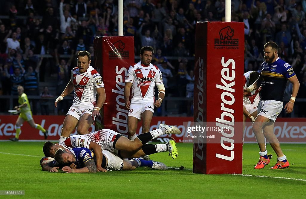 Jamie Peacock of Leeds Rhinos goes over for a try during the Ladbrokes Challenge Cup Semi-Final match between Leeds Rhinos and St Helens at the Halliwell Jones Stadium on July 31, 2015 in Warrington, England.