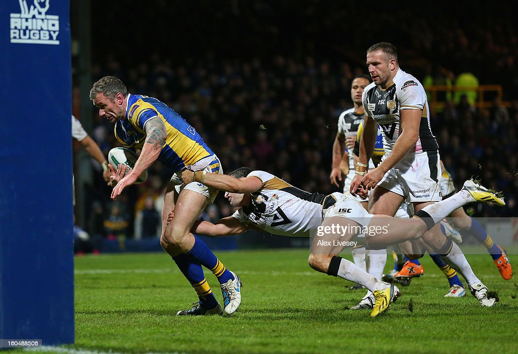 Jamie Peacock of Leeds Rhinos holds off a tackle from Shannon McDonnell of Hull FC on his way to scoring his try during the Stobart Super League match between Leeds Rhinos and Hull FC at Headingley Carnegie Stadium on February 1, 2013 in Leeds, England.