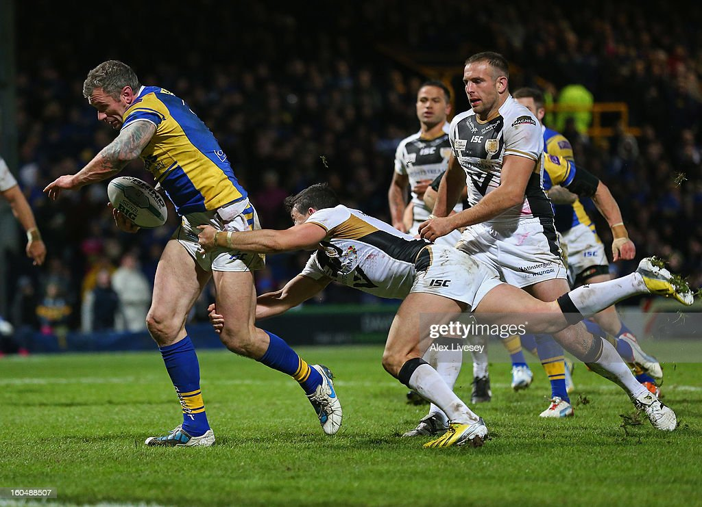 <a gi-track='captionPersonalityLinkClicked' href=/galleries/search?phrase=Jamie+Peacock&family=editorial&specificpeople=594610 ng-click='$event.stopPropagation()'>Jamie Peacock</a> of Leeds Rhinos holds off a tackle from Shannon McDonnell of Hull FC on his way to scoring his try during the Stobart Super League match between Leeds Rhinos and Hull FC at Headingley Carnegie Stadium on February 1, 2013 in Leeds, England.