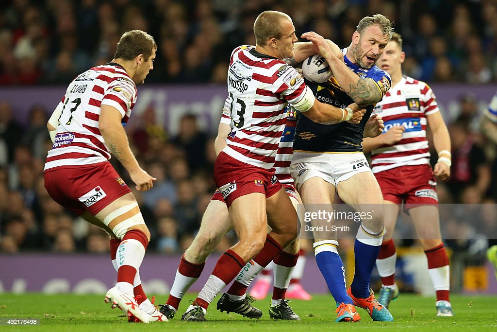Jamie Peacock of Leeds Rhinos holds the ball in a tackle from Lee Mossop of Wigan Warriors during the First Utility Super League Grand Final between Leeds Rhinos and Wigan Warriors at Old Trafford on October 10, 2015 in Manchester, England.