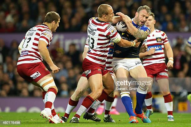 Jamie Peacock of Leeds Rhinos holds the ball in a tackle from Lee Mossop of Wigan Warriors during the First Utility Super League Grand Final between...